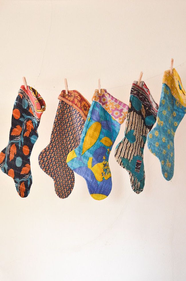 Stockings hung on a clothes line with clothing pins
