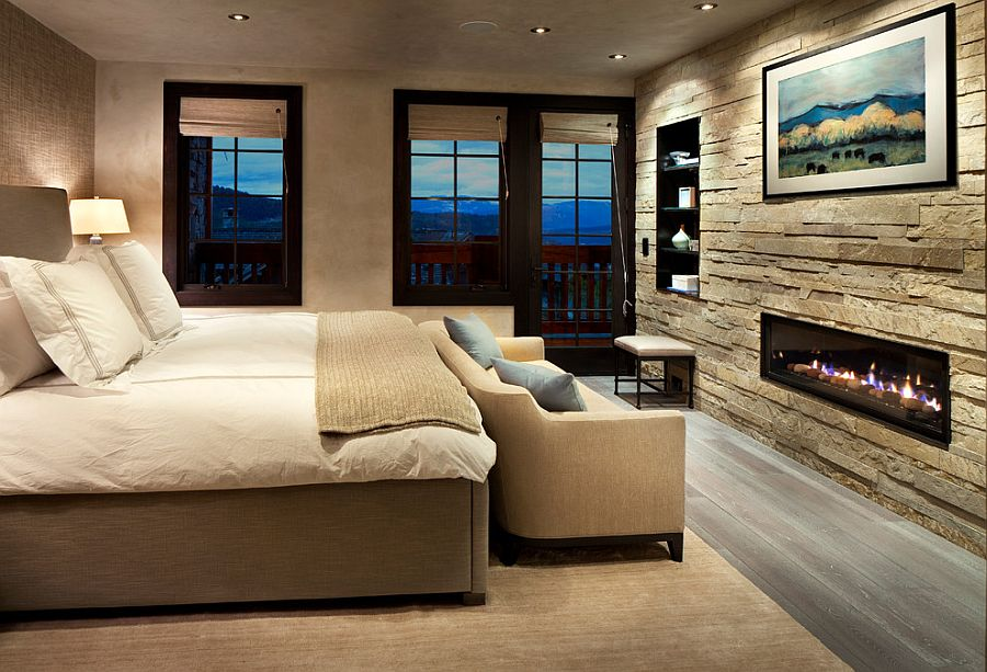 Stone accent wall brings textured elegance to the modern bedroom [Design: Lisa Kanning Interior Design]