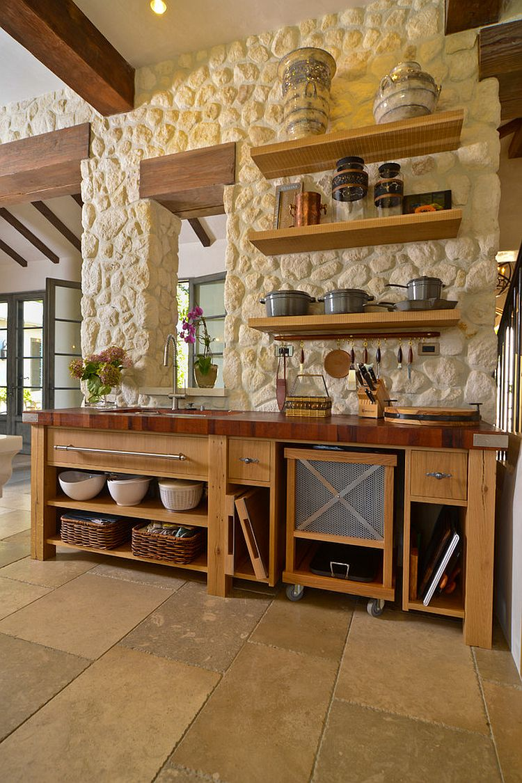... Stone and stucco house with a gorgeous Mediterranean kitchen that fits  in with its overall ambiance