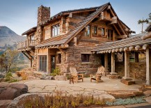 Stone walls and Rough-hewn timbers create one of a kind, rustic mountain home
