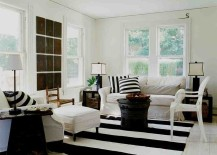 Striped rug, black coffee table and accent pillows for the shabby chic living room