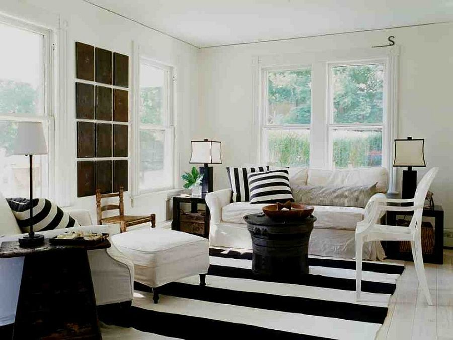 Striped rug, black coffee table and accent pillows for the shabby chic living room [Design: SchappacherWhite Architecture]