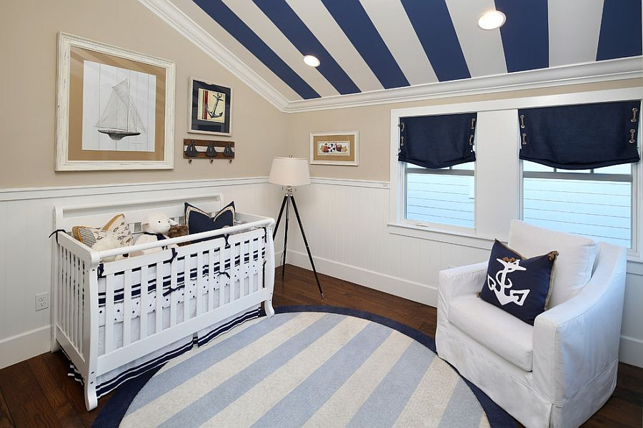 Stripes on the ceiling free up the walls in the nursery [Design: Robson Homes]