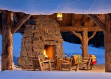 Stump-side-tables-wooden-chairs-and-cozy-stone-fireplace-make-a-magical-patio-at-Spanish-Peaks-Cabin-217x155