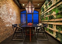 Stunning-dining-room-with-green-wall-on-one-side-and-a-brick-wall-on-the-other-217x155