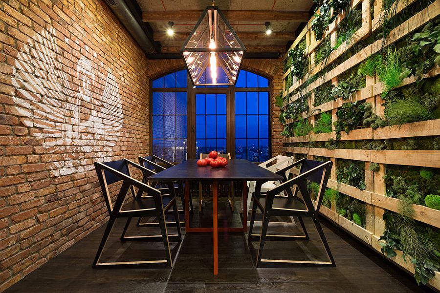 Stunning dining room with green wall on one side and a brick wall on the other! [Design: MARTIN architects]