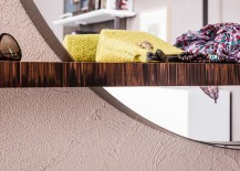Stylish combination of floating shelf and round mirror