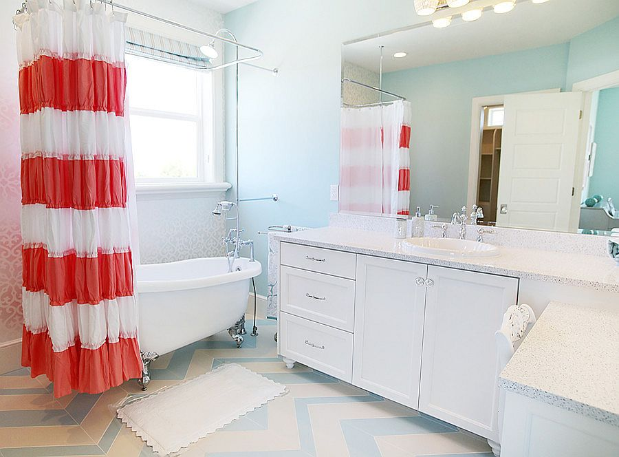Stylish shabby chic bathroom in coral, blue and white [Design: Four Chairs Furniture]