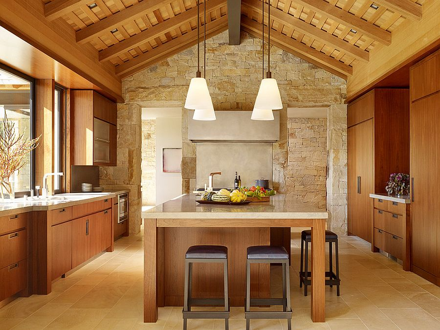 Textured limestone wall gives this kitchen a relaxed, farmhouse vibe [Design: Walker Warner Architects]