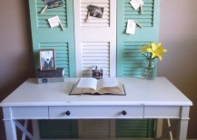 Three shutters used as a bulletin board in front of a desk 217x155 7 Inspiring Ways to Use Vintage Shutters on Your Walls
