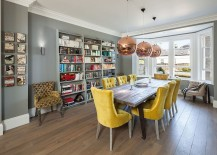 Tom-Dixon-pendant-lights-add-copper-glint-to-the-gray-and-yellow-dining-room-217x155