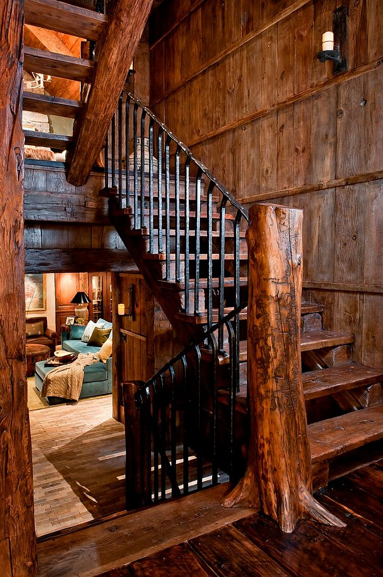 Treet trunk turned into a newel post adds to the rustic character of the staircase