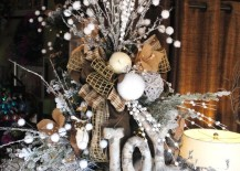 Twigs, burlap, styrofoam balls, and ribbon combined in a detailed tree topper