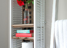Two shutters turned into a unique bathroom shelf 217x155 7 Inspiring Ways to Use Vintage Shutters on Your Walls