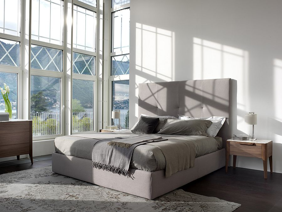 Upholstered headboard brings a touch of softness to the bedroom