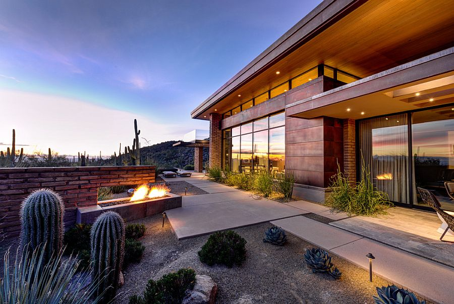 Use of adobe walls allows the home to blend in with the desert landscape
