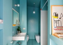 Use of light blue in the bathroom gives it a modern, cheerful vibe