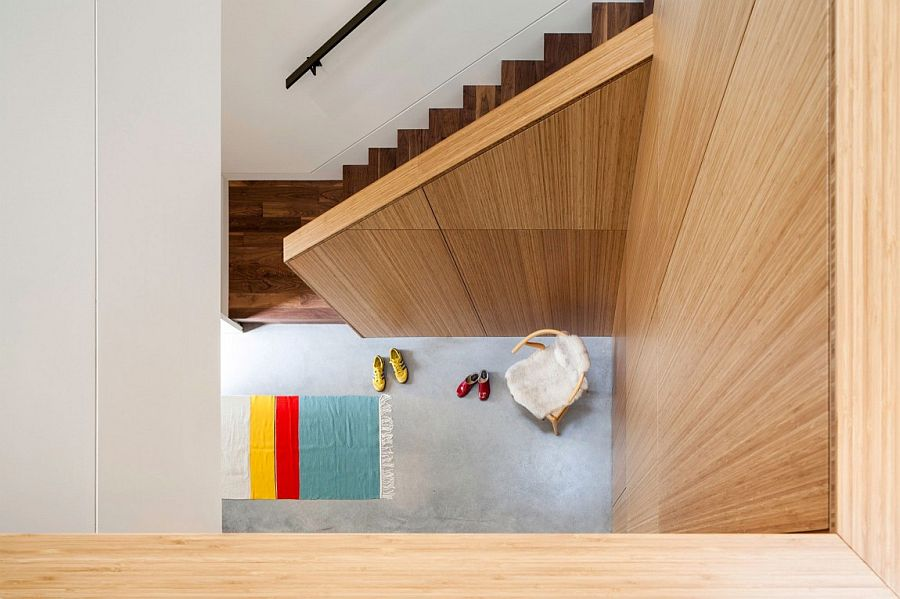 View of the custom wooden staircase from the top floor