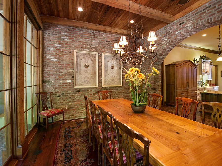 Vintage brick and lovely rug for the traditional dining room [Design: Terry M. Elston Builder]
