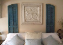 Vintage-shutters-and-artwork-used-in-place-of-a-headboard-217x155