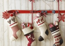 Vintage skis used to hang Christmas stockings 217x155 8 Festive Ways to Hang Stockings When You Dont Have a Fireplace