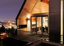 Wall-of-windows-opens-up-the-living-area-to-the-lovely-view-outside-217x155