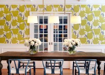 Wallpaper adds yellow while the dining table chairs bring a touch of bluish-gray to the dining room