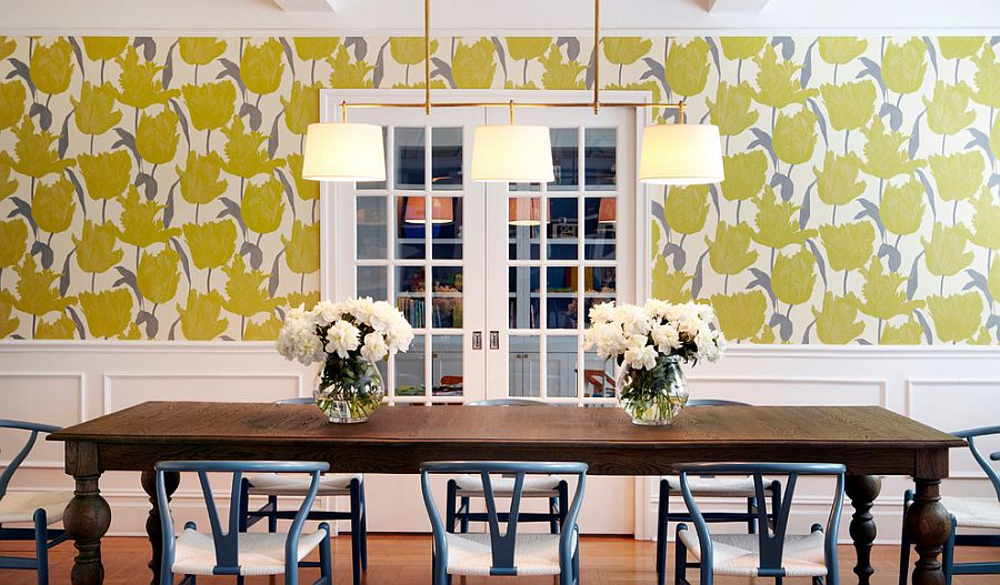 Wallpaper adds yellow while the dining table chairs bring a touch of bluish-gray to the dining room [Design: Chango & Co.]