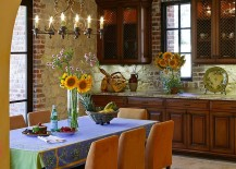 Walls-clad-in-natural-stone-and-brick-veneer-for-the-Mediterranean-dining-room-217x155