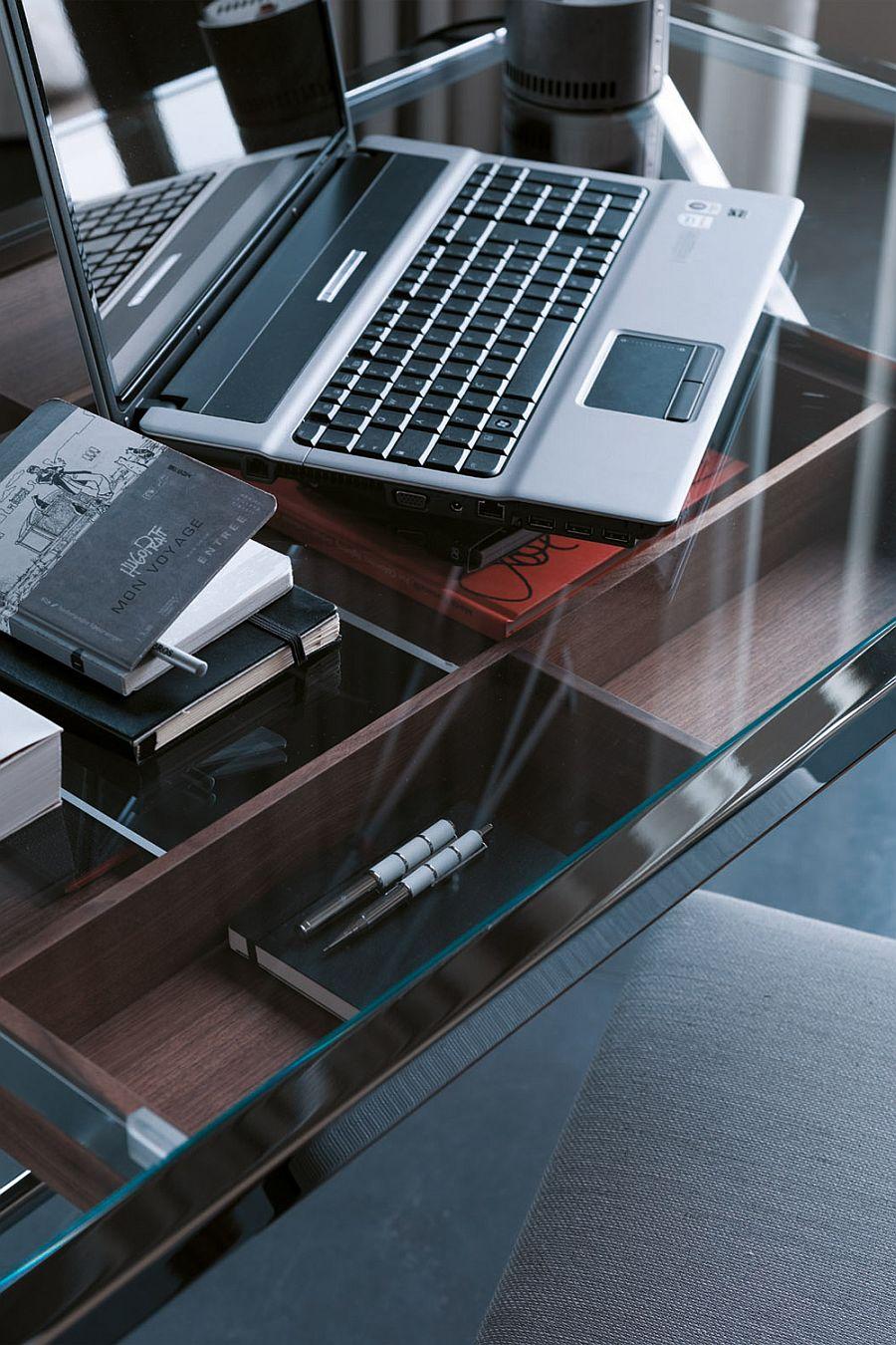 Walnut drawer of the desk under the glass desk top