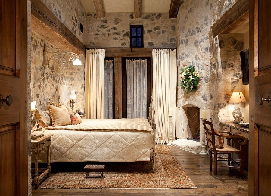 Warmth of the stone brings a dash of timelessness to the comfy bedroom [Design: Salcito Custom Homes]