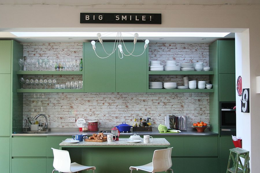 Whitewashed brick wall and colorful cabinets for the stylish, modern kitchen [Design: Aegis Interior Design]