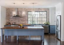 Whitewashed brick wall fits in with the modern appeal of the kitchen [Design: Pinney Designs]