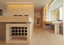 Wine storage built into the kitchen island elgantly