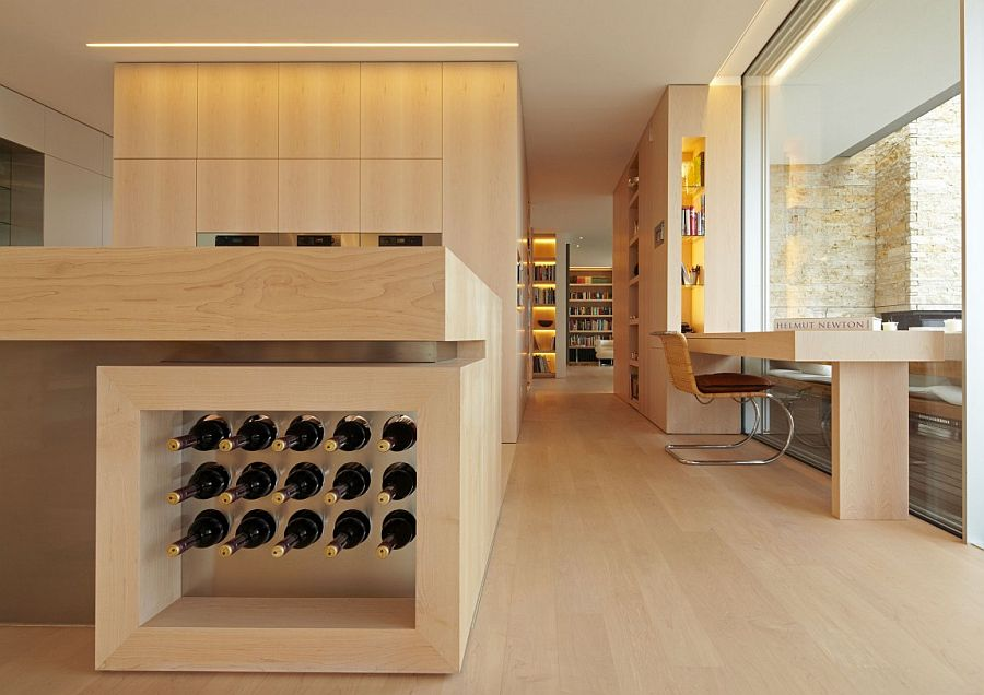 Wine storage built into the kitchen island elgantly