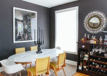 Yellow chairs add a bright accent hue to the dining room in white and gray