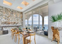A fusion of modern minimalism and the natural beauty of a stone wall 217x155 Fitting in with Every Style: Gorgeous Dining Rooms with Stone Walls