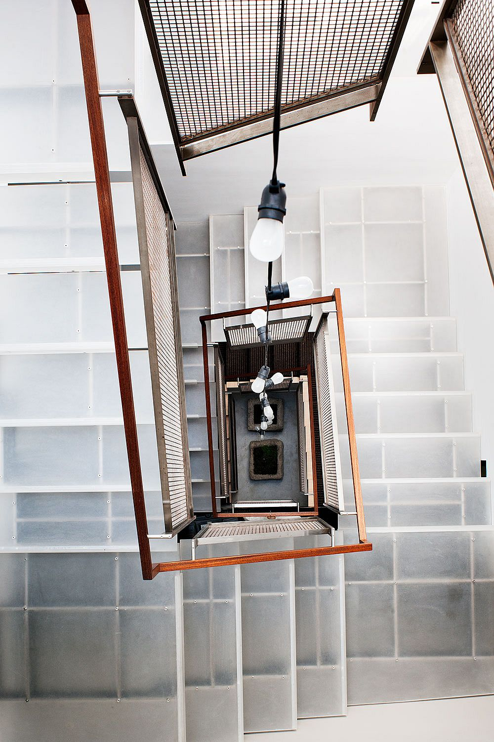 A look at the staircase from the top master suite level of the Noe Valley Residence