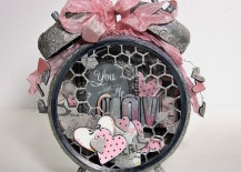 Altered alarm clock with a gray and pink love theme