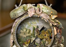 Altered-alarm-clock-with-flowers-and-an-arrow-inside-217x155