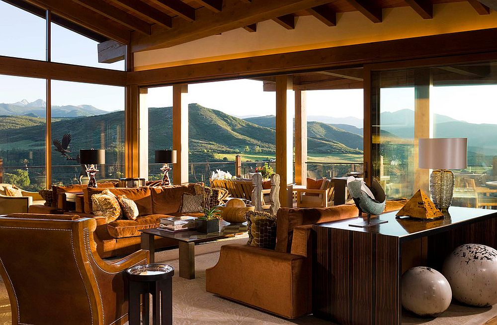 Amazing mountain views become a part of the open living room design with glass walls