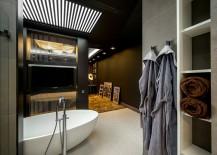 Bathroom allows you to enjoy your favorite tele shows as you take a dip