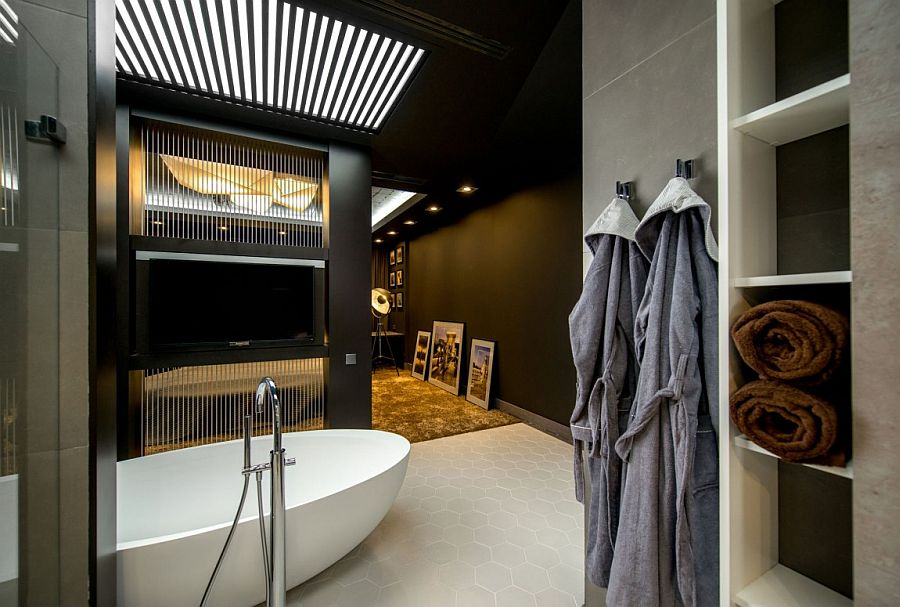 Bathroom allows you to enjoy your favorite tele shows as you take a dip
