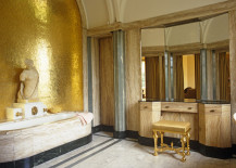 Bathroom vanity with a gold stool