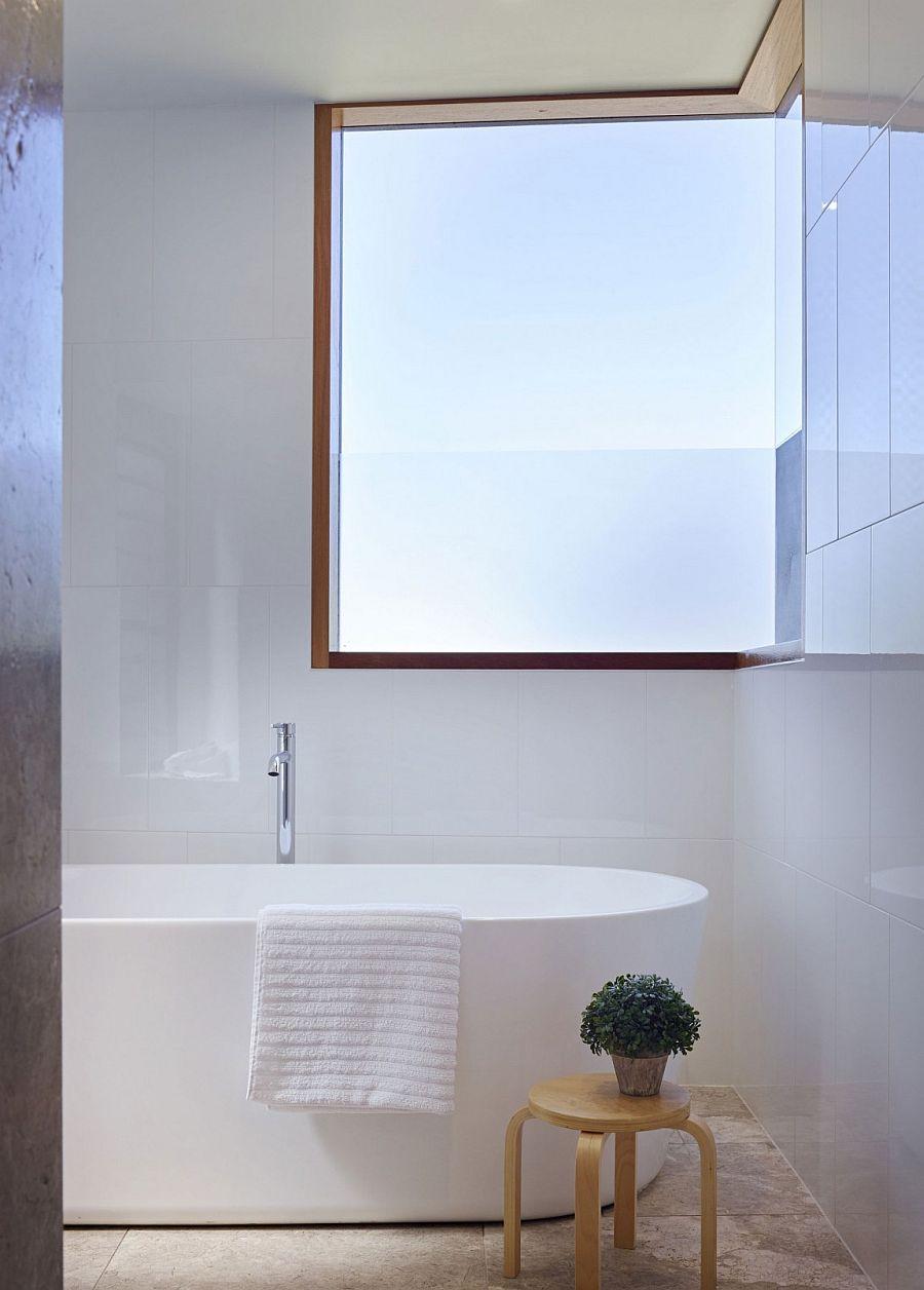 Beach style and contemporary elegance meet inside small bathroom