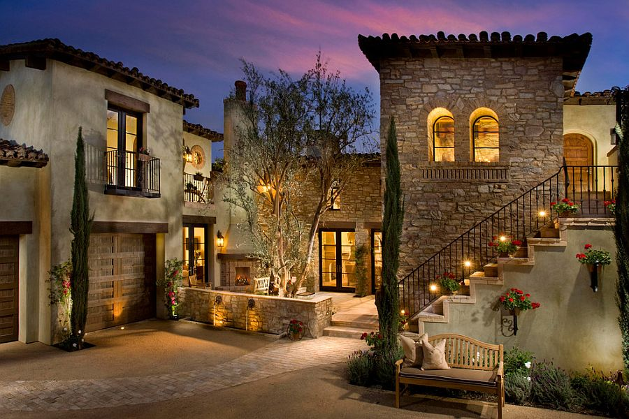 Beautiful Mediterranean home with gorgeous lighting and a series of balconies [Design: Maui Windows & Doors]