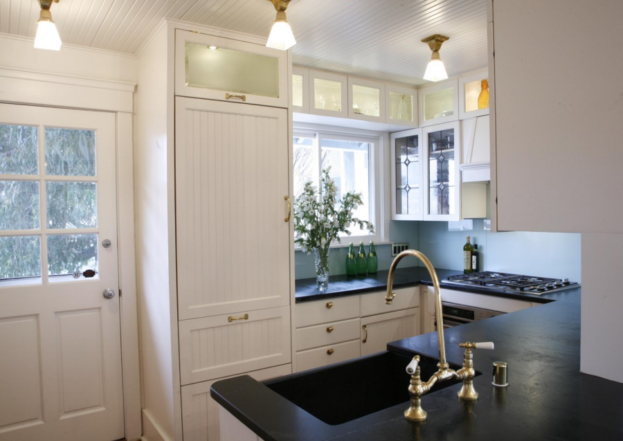 Beautifully designed kitchen with brass accents