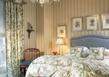 Bed skirt, antique chest and lighting usher in old world charm