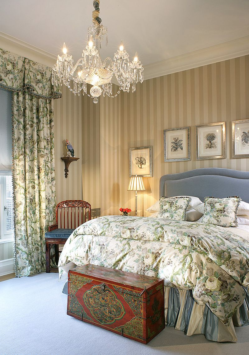 Bed skirt, antique chest and lighting usher in old world charm [Design: Treby Spanedda Interiors]