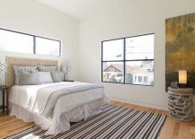Bedroom in white with a striped rug